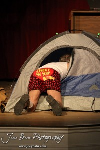"Duane played by K.B. Bell searches a tent during the Great Bend Community Theater's final rehearsal of  ""Duck Hunter Shoots Angel"" by Mitch Albom at Crest Theater in Great Bend, Kansas on April 17, 2013.  (Photo: Joey Bahr, www.joeybahr.com)"