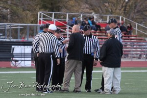 Great Bend Panther Head Coach Bo Black meets with the referees before the Salina Central versus Great Bend High School Football game with Salina Central winning 41 to 14  at Memorial Field in Great Bend, Kansas on October 25, 2013.  (Photo: Joey Bahr, www.joeybahr.com)