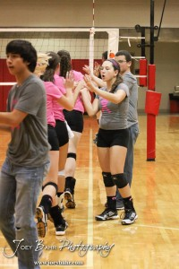 The Hoisington Lady Cardinals shake hands prior to the start of the Hoisington versus Smoky Valley volleyball match with Hoisington winning in two sets   at Hoisington Activity Center in Hoisington, Kansas on October 22, 2013.  (Photo: Joey Bahr, www.joeybahr.com)