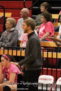 Hoisington Lady Cardinal Head Coach Jon Bingesser cheers on his team during the Hoisington versus Smoky Valley volleyball match with Hoisington winning in two sets   at Hoisington Activity Center in Hoisington, Kansas on October 22, 2013.  (Photo: Joey Bahr, www.joeybahr.com)
