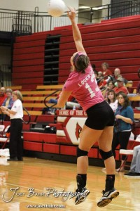 Hoisington Lady Cardinal Ashley Lockwood (#13) serves during the Hoisington versus Smoky Valley volleyball match with Hoisington winning in two sets   at Hoisington Activity Center in Hoisington, Kansas on October 22, 2013.  (Photo: Joey Bahr, www.joeybahr.com)