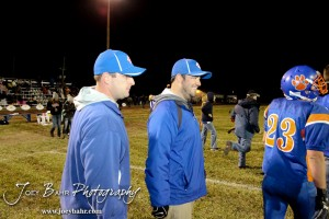 Otis-Bison Cougar Head Coach Travis Starr and Assistant Coach Curtis Little smile after winning the Sylvan-Lucas vs Otis-Bison High School football game with Otis-Bison winning 32 to 30 at Otis-Bison High School Field in Otis, Kansas on October 31, 2013.  (Photo: Joey Bahr, www.joeybahr.com)