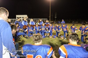 The Otis-Bison Cougars pray following the Sylvan-Lucas vs Otis-Bison High School football game with Otis-Bison winning 32 to 30 at Otis-Bison High School Field in Otis, Kansas on October 31, 2013.  (Photo: Joey Bahr, www.joeybahr.com)