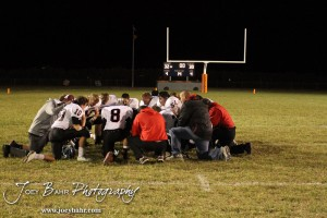 The Sylvan-Lucas Mustangs pray following the Sylvan-Lucas vs Otis-Bison High School football game with Otis-Bison winning 32 to 30 at Otis-Bison High School Field in Otis, Kansas on October 31, 2013.  (Photo: Joey Bahr, www.joeybahr.com)