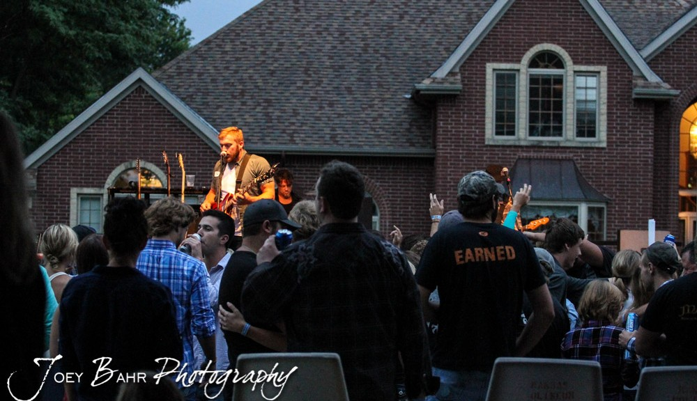 The crowd listens to Logan Mize perform durning the Ellinwood After Harvest Festival at  City Park in Ellinwood, Kansas on July 17, 2014.  (Photo: Joey Bahr, www.joeybahr.com)