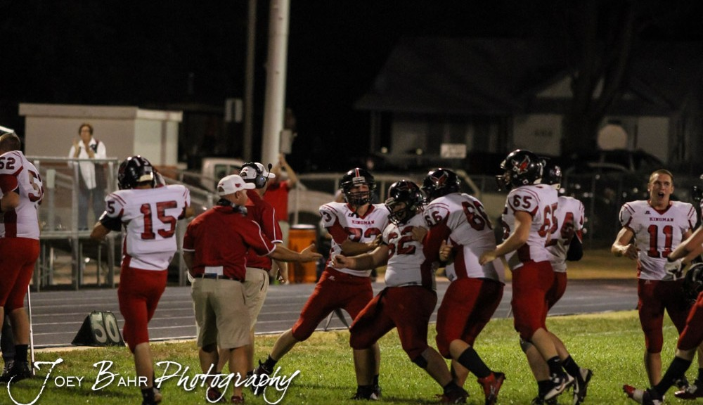 The Kingman Eagles congratulate  Caden Knoblauch (#62) on successfully kicking the field goal that would win the game during the Kingman Eagles versus Larned Indians High School Football Game with Kingman winning 3 to 0 at Earl Roberts Field at Larned High School near Larned, Kansas on September 19, 2014.  (Photo: Joey Bahr, www.joeybahr.com)