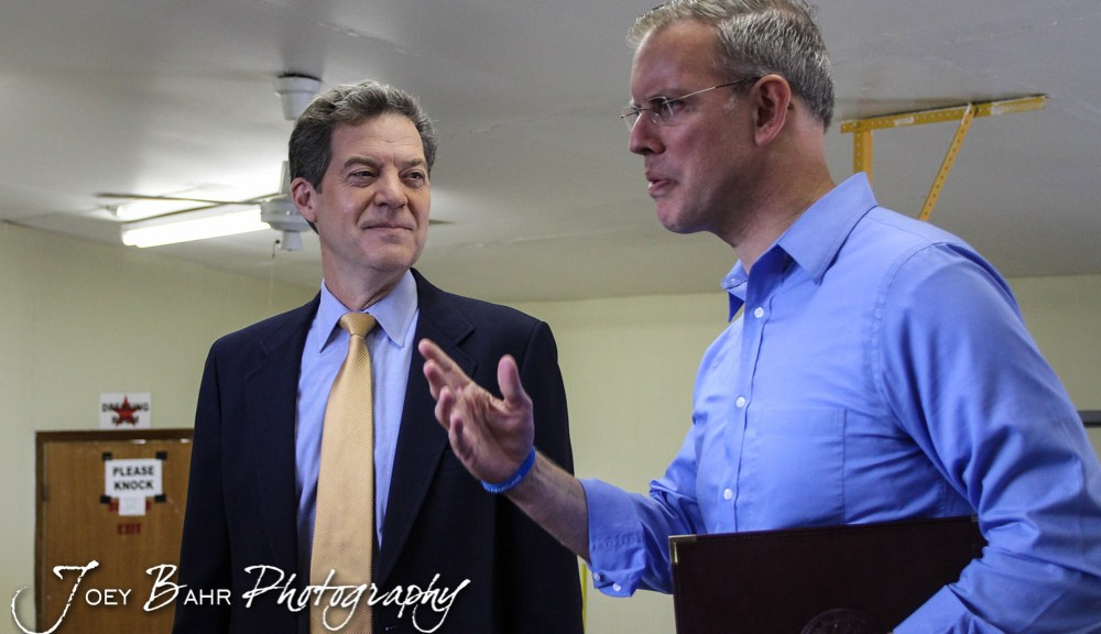 a discussion on the kansas governor race between sam brownback and paul davis Topeka, kan - normally, gov sam brownback is seen as a happy-go-lucky-guy but times aren't so happy right now for the kansas governor he faces a tight race in.
