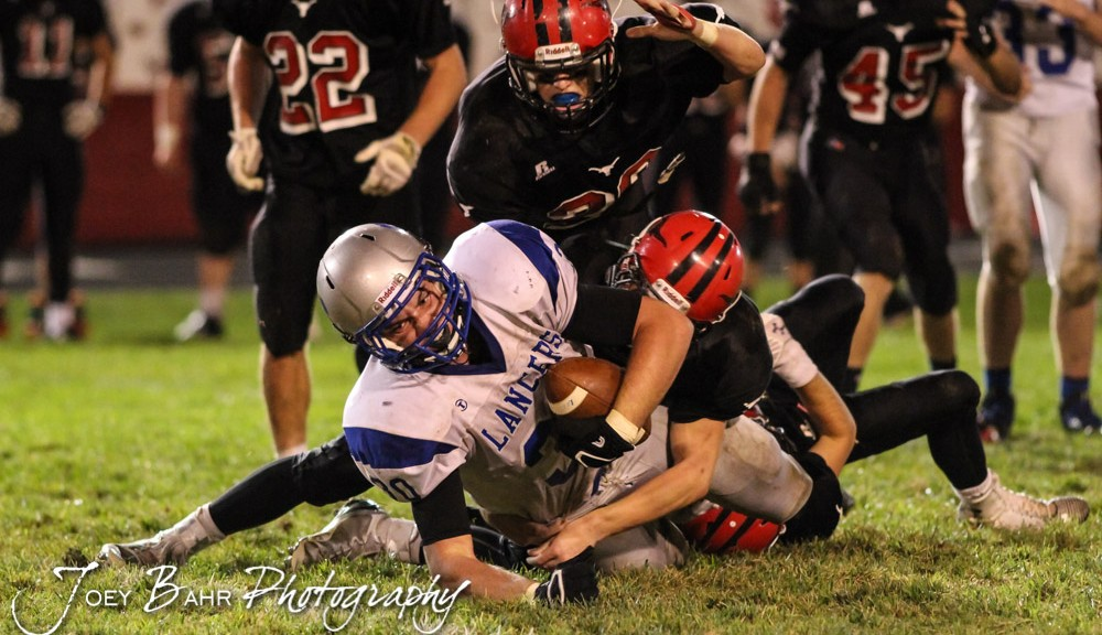 Spearville Lancer Kaden Stein (#30) tries to extend for more yards during the Spearville at Hodgeman County High School Football Game with Spearville winning 50 to 28 at Sayler Field in Jetmore, Kansas on October 24, 2014.  (Photo: Joey Bahr, www.joeybahr.com)