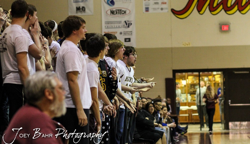 Hays High students cheer on their team during the 4A Division I Sub-State First Round Game with the Hays Indians and Buhler Crusaders with Hays winning 60 to 53 at Hays High School in Hays, Kansas on March 5, 2015.  (Photo: Joey Bahr, www.joeybahr.com)