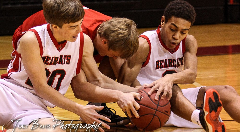 Ellsworth Bearcats Nick Flynn (#20) and Jordan Base (#3) and Hoisington Cardinal Grant Dolechek (#22) fight for a loose ball during the 2016 Hoisington Winter Jam First Round Boys Basketball game between the Hoisington Cardinals and the Ellsworth Bearcats with Hoisington winning 57 to 53 of Hoisington Activity Center in Hoisington, Kansas on January 19, 2016. (Photo: Joey Bahr, www.joeybahr.com)