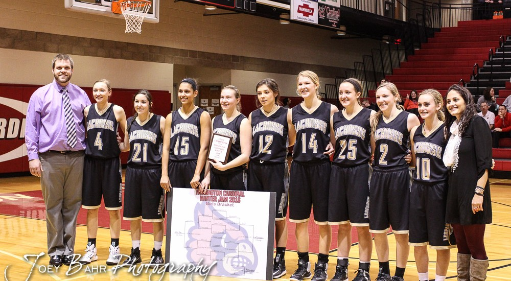 The LaCrosse Lady Leopards line up for pictures with the Championship Trophy and Bracket following the 2016 Hoisington Winter Jam Girls Championship Basketball game between the LaCrosse Lady Leopards and the Russell Lady Broncos with LaCrosse winning 54 to 48 of Hoisington Activity Center in Hoisington, Kansas on January 23, 2016. (Photo: Joey Bahr, www.joeybahr.com)