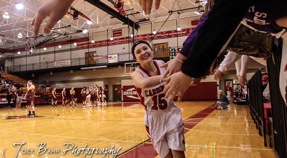 Hoisington Lady Cardinal Emma Harmon (#15) greets fans before the 2016 Hoisington Winter Jam First Round Girls Basketball game between the Hoisington Lady Cardinals and the Victoria Lady Knights with Hoisington winning 44 to 34 of Hoisington Activity Center in Hoisington, Kansas on January 19, 2016. (Photo: Joey Bahr, www.joeybahr.com)