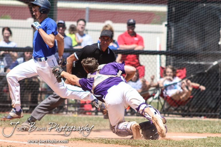 St. Mary's Colgan Panther Sawyer Esch (#7) avoids the tag of Medicine Lodge Indian Catcher William Axeline (#1) to score a run. The St. Mary's Colgan Panthers win the KSHSAA Class 2-1A State Baseball Championship over the Medicine Lodge Indians by a score of 13 to 3 at the Great Bend Sports Complex in Great Bend, Kansas on May 28, 2016. (Photo: Joey Bahr, www.joeybahr.com)