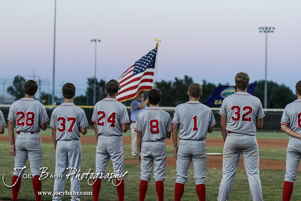 The Great Bend Braves stand before the color guard prior to the start of the game. The Great Bend Braves won their first round game over Doniphan County 14 to 4 in the American Legional Class A Baseball State Tournament at the Great Bend Sports Complex in Great Bend, Kansas on July 20, 2016. (Photo: Joey Bahr, www.joeybahr.com)