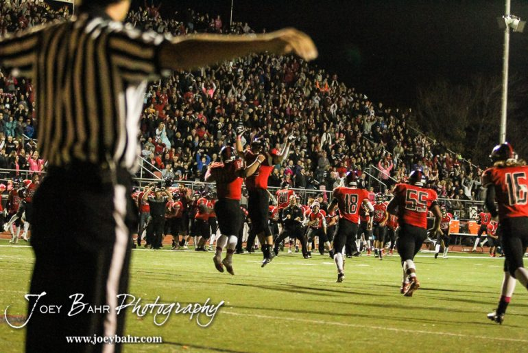 The Great Bend Panthers celebrate after Garden City misses a field goal and force overtime. The Garden City Buffaloes defeated the Great Bend Panthers 21 to 14 in Overtime to win the Western Athletic Conference title at Memorial Stadium in Great Bend, Kansas on October 21, 2016. (Photo: Joey Bahr, www.joeybahr.com)