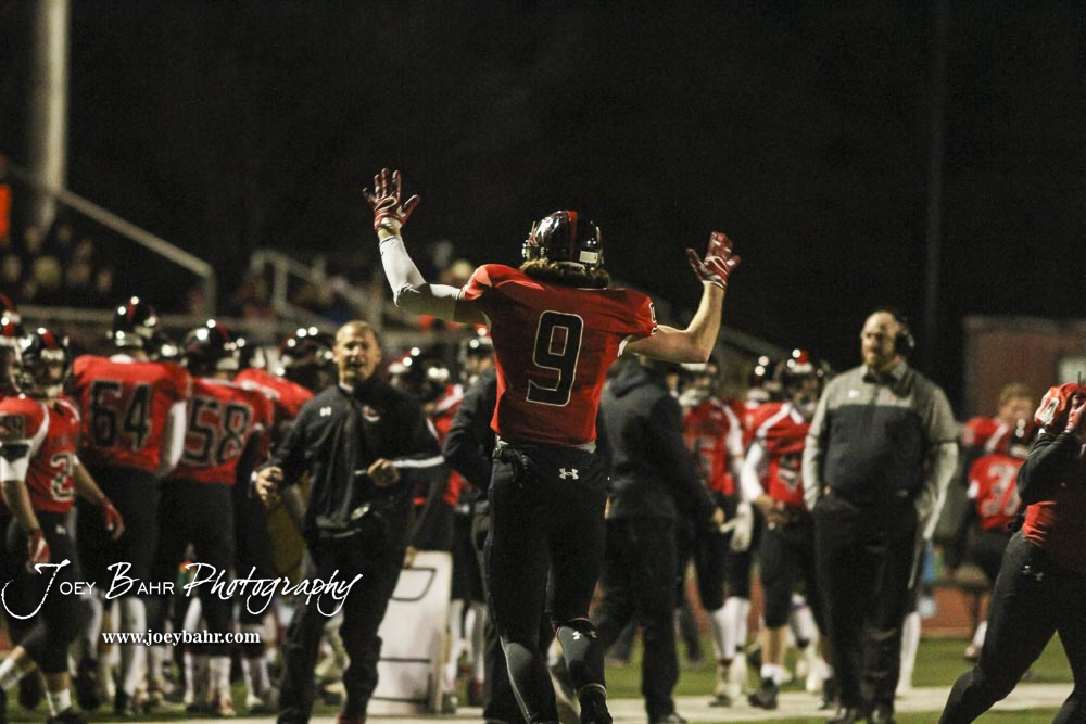 Great Bend Panther Brayden Smith (#9) holds up his hands in celebration of the touchdown he just scored. The Great Bend Panthers defeated the Valley Center Hornets to win the KSHSAA Class 5A Sectional by a score of 28 to 24 at Memorial Field in Great Bend, Kansas on November 11, 2016. (Photo: Joey Bahr, www.joeybahr.com)