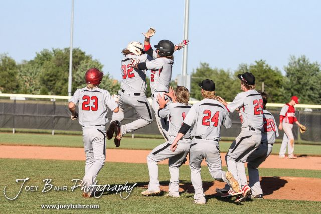 Great Bend Panther players celebrate near the mound
