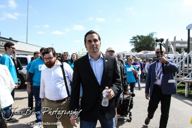 Greg Orman walks to meet voters